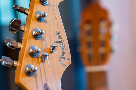 Scandia, MN - September 10, 2019: Close up of a Fender Stratocaster Guitar, showing the strings and brand Editorial