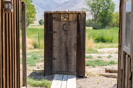 Old fashioned wooden outhouse bathroom portable potty, out in the countryside Reklamní fotografie