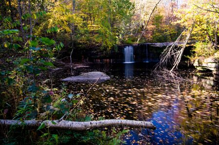 Waterfall in Banning State Park long exposure during daytime in the fall with beautiful fall foliage colors to the trees