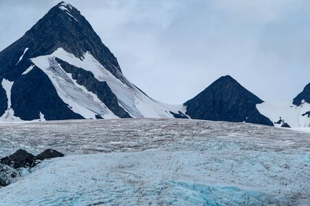 Worthington Glacier in Valdez Alaska - close up view of the top of the ice and mountain peaks