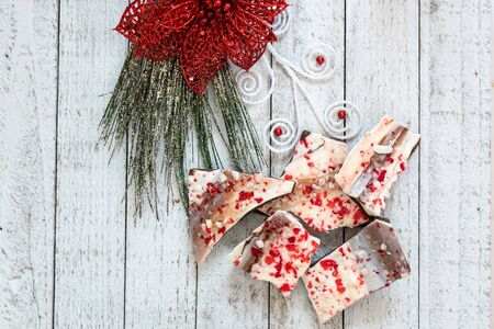 Close up of Christmas Peppermint Bark with white and dark chocolate, sprinkled with candy cane bits