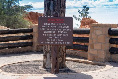 Warning sign posted at Bryce Canyon National Park informs tourists of dangerous conditions on the trails Editorial