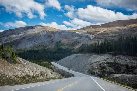 Highway road in the Icefields Parkway in Jasper and Banff National Parks in Alberta Canada, in the Canadian Rockies Stock Photo