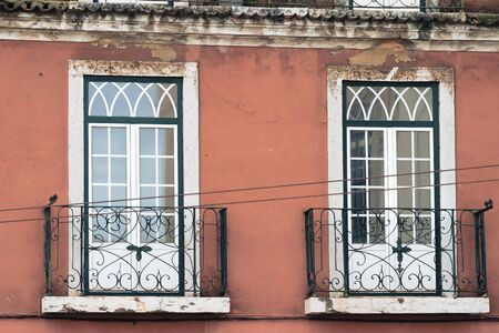 Cute traditional windows with balconies in Portugal