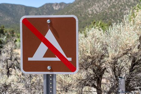 No camping sign. Sunny day in the desert in background Archivio Fotografico
