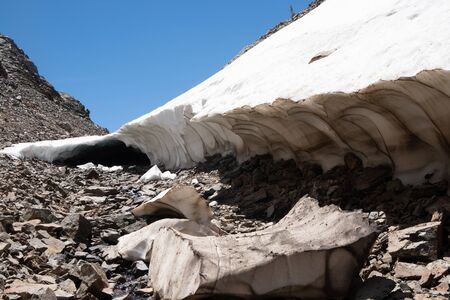 Snow cave in the summer along the 20 Lakes Basin trail in Sierra Nevada California