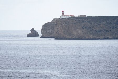 Lighthouse at the Cabo De Sao Vicente in Sagres in Algarve Portugal on overcast day 版權商用圖片
