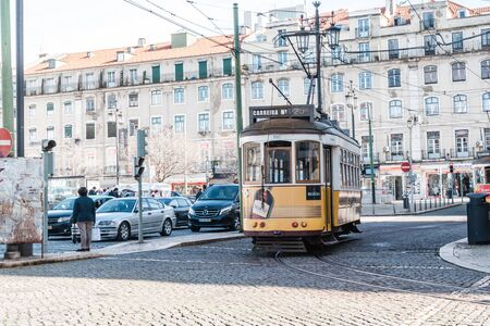 Lisbon, Portugal - January 17, 2020: An Iconic Lisbon (streetcar) tram moving along the streets near Rossio Square Stock Photo - 139041956