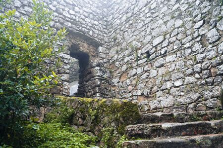 Small doorway and steps at the Moorish Castle (Castle of Moors) in Sintra Portugal on an overcast day in the winter Editorial