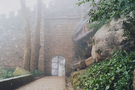 Gated entrance to the Moorish Castle in Sintra Portugal on a foggy misty day Stock Photo - 139041959