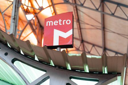 Lisbon, Portugal - January 18, 2020: Metro subway sign inside the Rossio Train Station, to connect commuter trains to the Lisbon Subway Editorial