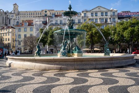 Lisbon, Portugal - January 17, 2020: Fountain of the Praça do Rossio square in the center plaza of Lisbon, Portugal Editorial