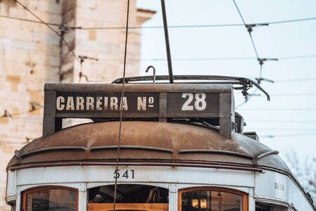 Lisbon, Portugal - January 17, 2020: Close up of the street car (english translation from Carreira) 28, the famous yellow tourist tram