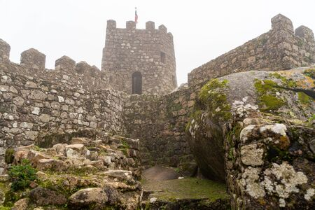 Foggy view of a watchtower at the Moorish Castle in Sintra Portugal on a foggy day
