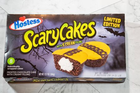 Hostess Brand Scary Cakes cupcakes with filling feature orange frosing with brown swirls. Limited edition Halloween seasonal item