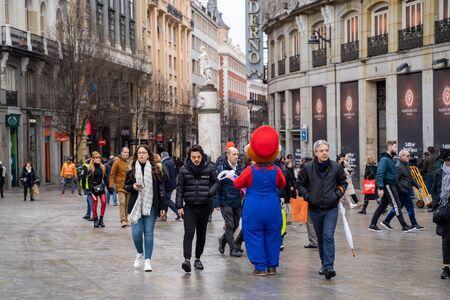 Madrid, Spain - January 25, 2020: Super Mario character harrasses tourists walking along the Plaza Mayor area of downtown Madrid