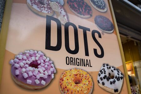 Madrid, Spain - January 25, 2020: Sign advertising Dots Bakery and their famous donuts Editorial