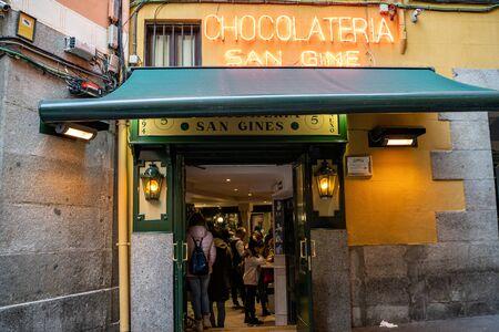 Madrid, Spain - January 25, 2020: Famous Chocolatería San Ginés selling chocolate churros located in Pasadizo de San Gines.