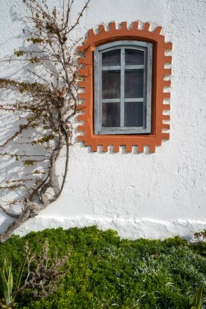 Window of the former whitewashed fishermen huts at Praia do Barril beach, in Tavira, Algarve, Portugal