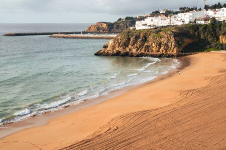 Coastal view of Albuferia in the Algarve region of Portgual, showing the beach, cliffs and jetty Stock Photo - 139078320