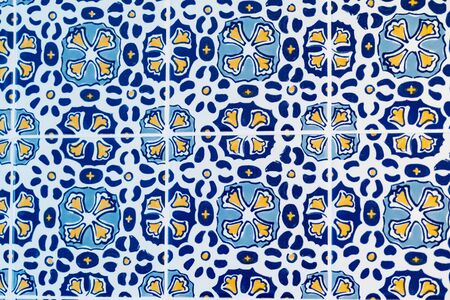 Mosaic of traditional Portugal tiles (azulejo) in blue, yellow and white colors