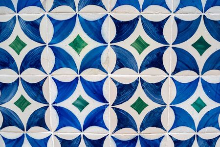 Handpainted blue, white and green tiles in the Alfama district of Lisbon Portugal