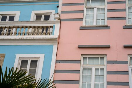 Pastel pink and blue buildings in Lagos, Portugal, in the Algarve region