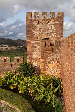 Golden hour view of Silves Castle ruins and watchtower in the winter sunshine