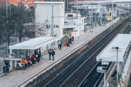 Lisbon, Portugal - January 17, 2020: Passengers wait for the train at the Belem railway station in Lisbon