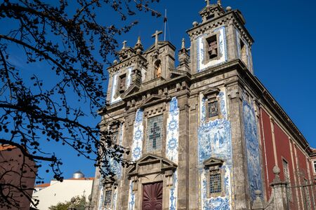 Exterior of the Church of Saint Ildefonso in Porto, Portugal on a sunny day