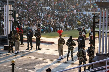 Amritsar India- Febuary 8, 2020: Pakistani rangers prepare to face off with Indian Border Security Force at Wagah Border Closing Ceremony Editorial