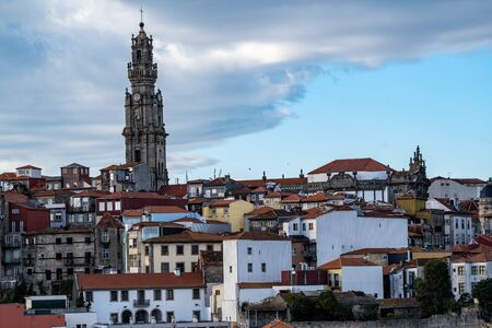 Viewpoint of the red clay rooftops and tower of the Clerigos Church (Baroque style church with bell tower) in Porto Portugal