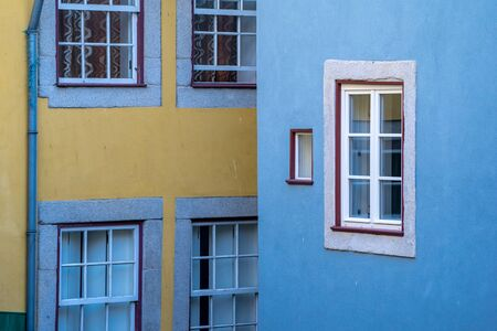 Abstract photo of blue and yellow colorful building walls in Porto, Portugal