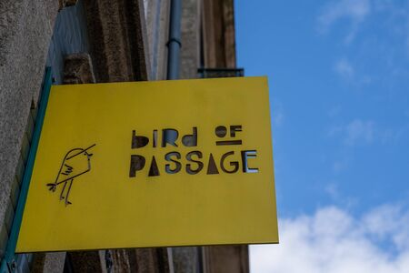 Porto, Portugal - January 20, 2020: Sign for the Bird of Passage coffee shop and restaurant in downtown Porto