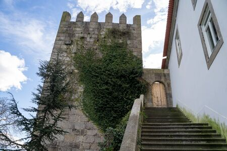 Porto, Portugal - January 20, 2020: The Muralha Primitiva (Primitive Wall) building remains and steps 新聞圖片