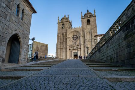 Porto, Portugal - January 20, 2020: Porto Se Cathedral Church as seen from the cobblestone walkway path on a sunny winter day