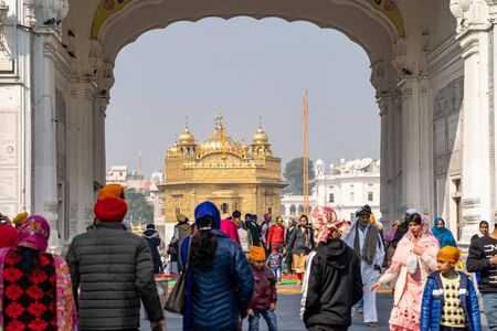 Amritsar India - Febuary 8, 2020: Sikh Golden Temple (sri harmandir sahib), with crowds of people paying respects and praying Stock fotó - 140734667