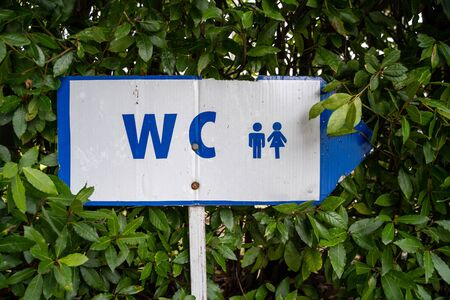 Sign for the WC (watercloset, or toliet) in blue and white, for men and women