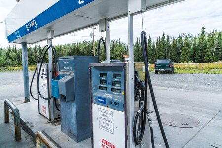 AUGUST 12 2018 - CHITNIA ALASKA: Old fashioned gas station pumps from the 1970s are still in use in some Alaskan towns. These pumps do not take credit cards or pay at the pump 新聞圖片