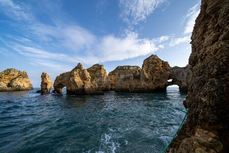 Scenic natural cliff formations and arches of Algarve coastline with turquoise water at Ponta da Piedade, in Algarve Portugal 版權商用圖片