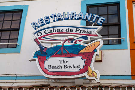 Albuferia, Portugal - January 23, 2020: Sign and logo for The Beach Basket, a restaurant in downtown Albuferia in the Algarve region