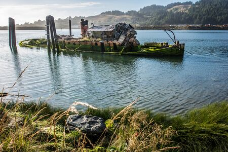 Remains of the abandoned shipwreck of the Mary D. Hume, in Gold Beach Oregon, along the Rouge River