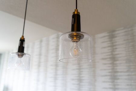 Modern looking kitchen hanging light fixtures inside a house features an exposed lightbulb