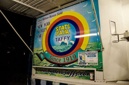 Falcon Heights, Minnesota - August 25, 2018: Sign for the State Fair Taffy booth, sold at the New York Worlds Fair at the MInnesota State Fair