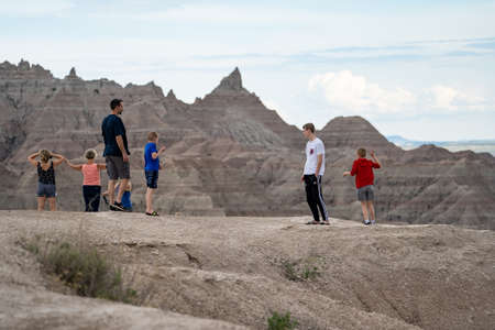 Scenic, South Dakota - June 21, 2020: Tourists family explores and enjoys the scenery in Badlands National Park while on summer vacation