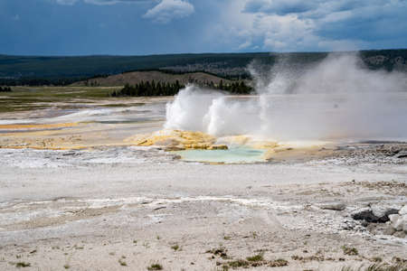 Erupting Clepsydra Geyser along the Fountain Paint Pot trail in Yellowstone National Park