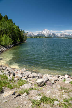 Shores of Jackson Lake, near the Jackson Lake Dam in Grand Teton National Park on a sunny summer day