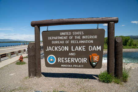 Grand Teton National Park, Wyoming - June 26, 2020: Sign for the Jackson Lake Dam and Reservior, part of the US Department of the Interior Bureau of Reclamation Editorial