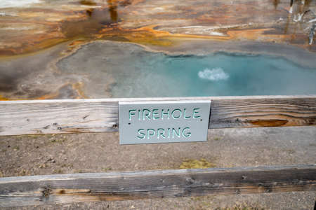 Sign for Firehole Spring, a hot spring thermal feature along Firehole Lake Drive in Yellowstone National Park 版權商用圖片