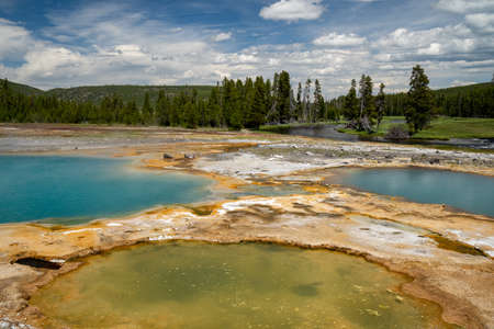 Three beautiful, colorful hot springs geothermal features in Biscuit Basin area of Yellowstone National Park